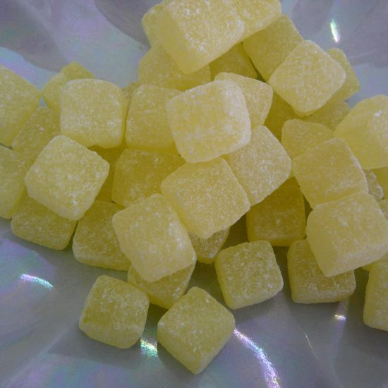 Traditional boiled square sweet with a pineapple taste